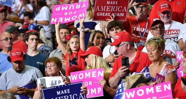 "f167ed6c60f Supporters of Donald Trump, some with ""Women for Trump"" placards, attend a"