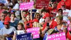 "Supporters of Donald Trump, some with ""Women for Trump"" placards, attend a rally given by the US president in Mississippi on Tuesday. Photograph: Mandel Ngan/AFP/Getty Images"
