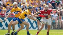 Pat Horgan in action against Clare's David McInerney during this year's Munster final at Semple Stadium. Photograph: Morgan Treacy/Inpho