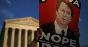 Protesters demonstrate against supreme court nominee Brett Kavanaugh outside the US supreme court  in Washington. Photograph: Getty Images