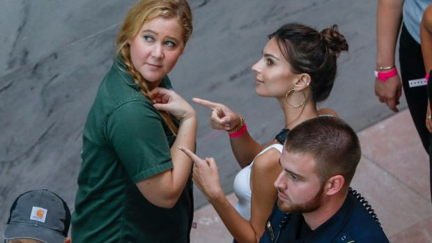 US comedian Amy Schumer (L) and US actress Emily Ratajkowski (R) gesture after getting arrested. Photograph: Erik S. Lesser/EPA