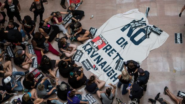 Demonstrators protest the Supreme Court nomination of judge Brett Kavanaugh in the Hart Senate Office Building in Washington on Thursday. Photograph: The New York Times
