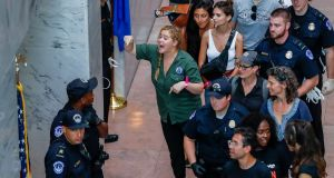 US comedian Amy Schumer gestures after getting detained along with hundreds of other protestors. Photograph:   EPA