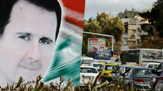 A banner bearing a portrait of Bashar al-Assad in a street in Damascus in March 2015. Photograph: Louai Beshara/AFP/Getty Images