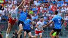 Dublin's Brian Fenton contests an aerial ball with Tyrone's Colm Cavanagh  during this year's All-Ireland final. Photograph: Tommy Dickson/Inpho
