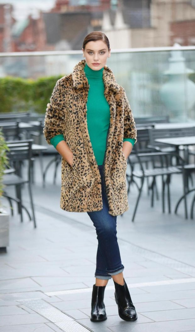 Leopardprint faux fur coat, €110; relaxed slim leg jeans, €34; ribbed polo neck, €24