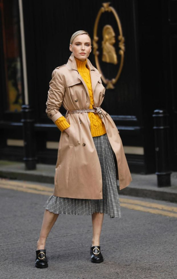 Longline trench coat with stormwear, €110; cable-knit funnel neck jumper M&S collection, €47.50; checked asymmetric pleated midi skirt, €55