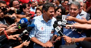 Brazilian presidential candidate for the Workers' Party (PT) Fernando Haddad speaks to the press during a campaign rally in Belo Horizonte,  on Friday. Photograph: Getty Images