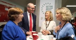 Chris Winning, Margaret Horgan, Una Scally and  Tánaiste  Simon Coveney,  at the Getting Ireland Brexit Ready conference in Cork. Photograph: Julien Behal