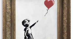 Posting a picture of the moment on Instagram, Banksy wrote: 'Going, going, gone . . .'