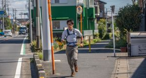 Boston Marathon winner Yuki Kawauchi runs to work in his home town of Kuki, Japan. Kawauchi  will compete in Sunday's Chicago Marathon, his ninth marathon of the year. Photograph:  Shiho Fukada/The New York Times