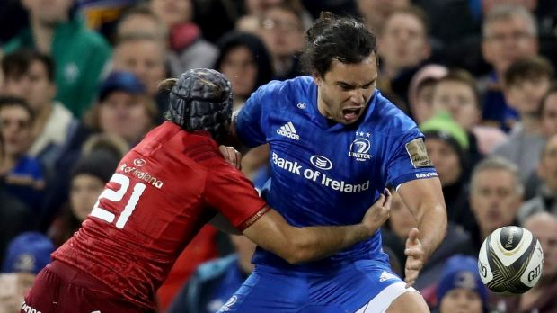 Leinster's James Lowe in action against Duncan Williams of Munster during the Guinness Pro 14 game at the Aviva stadium. Photograph: Bryan Keane/Inpho