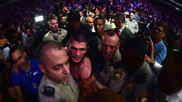 Khabib Nurmagomedov is escorted out of the arena after his win over Conor McGregor. Photograph: Harry How/Getty