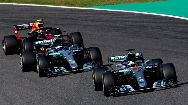 Lewis Hamilton leads en route to victory at Suzuka. Photograph: Diego Azubel/EPA