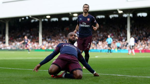 Alexandre Lacazette celebrates scoring his and Arsenal's second at Craven Cottage. Photograph: Catherine Ivill/Getty