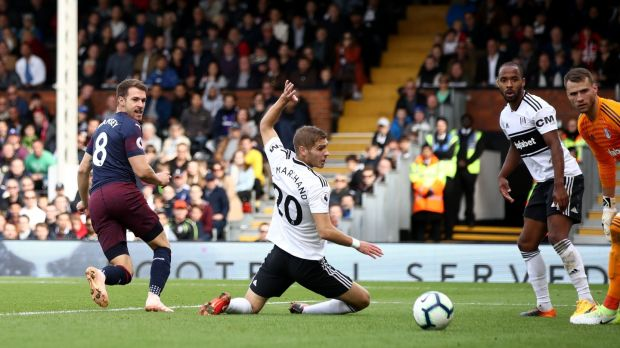 Aaron Ramsey backheels Arsenal's thrid home against Fulham. Photograph: John Walton/PA