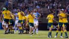 Australia celebrate an extraordinary win over Argentina in Salta. Trailing 31-7 at the interval they scored five unanswered tries to prevail 45-34. Photograph: Florencia Tan Jun/Reuters