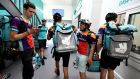"Deliveroo riders waiting for their  instructions at one of the company's first  ""editions"" kitchens in France in July 2018, in Saint-Ouen, outside Paris. Photograph: Gerard Julien/AFP"