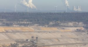 Smoke billows on the horizon from coal-powered plants in Hambach, Germany. Photograph: Alex Kraus/Bloomberg