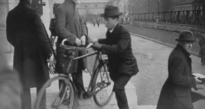 December 1921:  Cathal Brugha arrives by bicycle at a Dáil Éireann meeting in Dublin University. Photograph: Hulton Archive/Getty Images