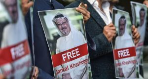 Protestors hold pictures of missing journalist Jamal Khashoggi during a demonstration in front of the Saudi Arabian consulate in Istanbul. Photograph:  Ozan Kose/AFP