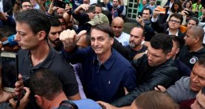 Jair Bolsonaro, presidential candidate of the Social Liberal Party, after casting his vote in Rio de Janeiro. Photograph: Pilar Olivares/Reuters
