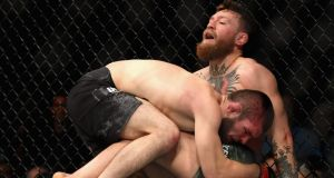 Khabib Nurmagomedov  holds down Conor McGregor during their UFC lightweight championship bout at UFC 229  in Las Vegas. Photograph: Harry How/Getty Images