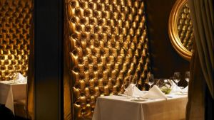 Saddle Room: the gold-lamé button-back upholstered booths chime with the Shelbourne restaurant's cappuccino carpets and walnut browns