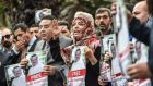 Nobel Peace Prize laureate Tawakkol Karman and Egyptian opposition politician Ayman Nour (left) hold pictures of missing journalist Jamal Khashoggi during a demonstration in front of the Saudi Arabian consulate in Istanbul on Monday. Photograph: Ozan Kose/AFP/Getty Images