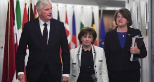 EU chief Brexit negotiator Michel Barnier  with DUP leader Arlene Foster (right), and DUP MEP Diane Dodds  at the European Commission in Brussels. Photograph: Emmanuel Dunand/ via AP