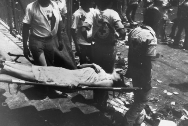 A woman is carried away on a stretcher after rioting and killing at Romero's funeral on March 30th, 1980 which was attended by more than 250,000 people. Estimates of how many died range from 30 to 50. Photograph: Keystone/Getty