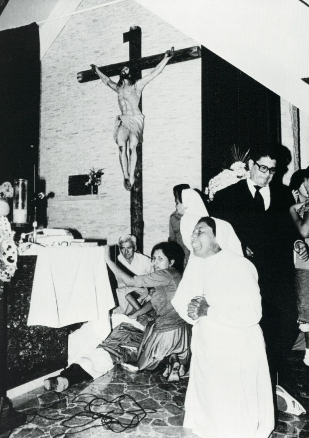 A nun kneels in prayer near the body of Archbishop Oscar Romero shortly after he was assassinated at the Divine Providence Hospital's Chapel on March 24th, 1980 Photograph: Bettmann Archive