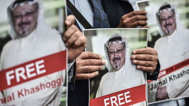 Protestors hold pictures of missing journalist Jamal Khashoggi during a demonstration in front of the Saudi Arabian consulate on Monday in Istanbul. Photograph: Zan Kose/AFP/Getty Images