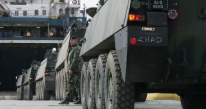Irish Army Mowag personnel carriers loading  onto a ship in Dublin  on their way to Chad for a UN mission