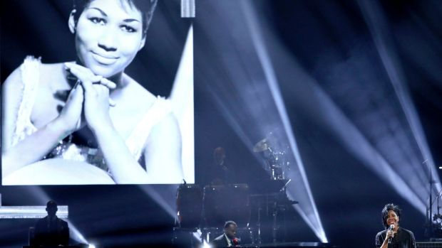 "Gladys Knight performs ""Amazing Grace"" during a tribute to the late singer Aretha Franklin, pictured on screen, at the American Music Awards in LOs Angeles. Photograph: Matt Sayles/Invision/AP"