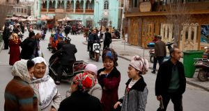 People mingle in the old town of Kashgar, Xinjiang region, China. Xinjiang is China's biggest province and the source of much of its oil and gas. Photograph:  Thomas Peter/Reuters
