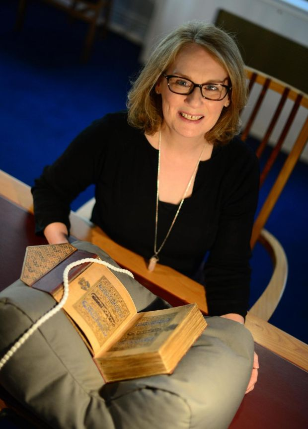 Chester Beatty Library: Fionnuala Croke with the Koran copied and illuminated by Ibn al-Bawwab, in Baghdad, between 1000 and 1001. Photograph: Bryan O'Brien
