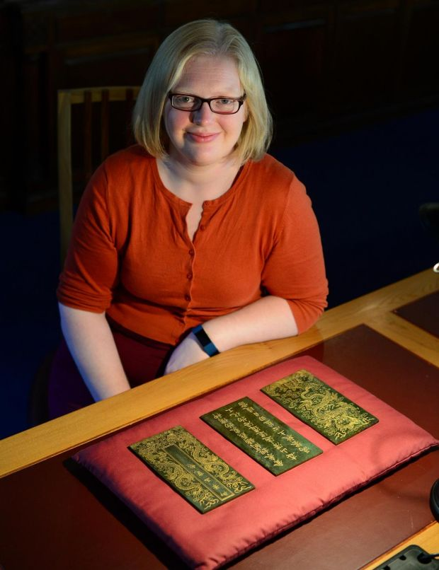 Chester Beatty Library: Mary Redfern with folios from the Song of the Jade Bowl. Photograph: Bryan O'Brien