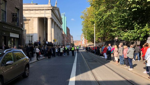 Crowds gather to pay their respects to the late Emma Mhic Mhathúna outside the Pro-Cathedral in Dublin on Wednesday. Photograph: Daniel Comer