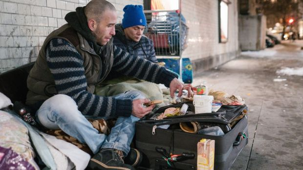 Homeless men from Bulgaria and Hungary at a train station in Hanover, central Germany. Bulgaria has lost almost 2 million people since 1989, revealing the massive impact of the transition from communism to capitalism on eastern Europe. Photograph: Getty Images
