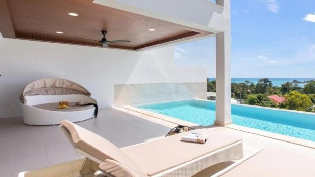 Thailand: this Koh Samui villa has sliding glass doors on to a terrace with a shaded area and infinity swimming pool