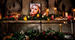 A portrait of murdered Bulgarian television journalist Viktoria Marinova during a candlelit vigil in the city of Ruse. Photograph: Dimitar Dilkoff/AFP/Getty Images