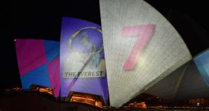The Sydney Opera House's sails controversially become a blank canvas for the advertisers of the Everest horse race. Photograph: Peter Parks/AFP