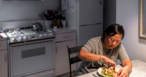 Anita Lo and her cauliflower chaat for one, in her New York apartment. Photograph: Daniel Krieger/The New York Times
