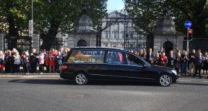 The funeral procession of Emma Mhic Mhathúna passes by Leinster House. Photograph: Garrett White/Collins