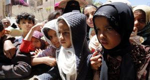 Children wait to receive food rations in Sana'a, Yemen. War-torn Yemen is one of six countries identified in a new report as having 'alarming' levels of hunger. Photograph: Yahya Arhab/ EPA