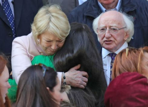 Emma Mhic Mhathúna's daughter, Natasha (15), is consoled by President Michael D Higgins and his wife Sabina at her mother's funeral in Dublin. Photograph: Colin Keegan, Collins Dublin