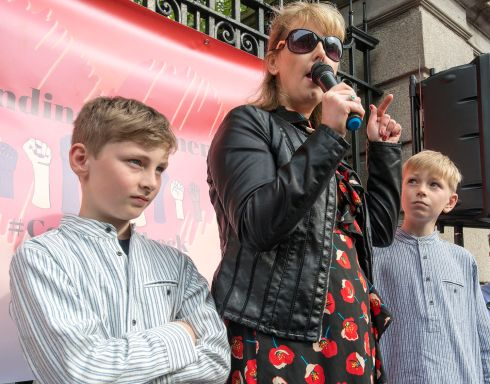 A protest in support of the 209 women affected by the Cervical Check scandal from May 2018 at Leinster House, organised by the Standing4Women campaign.  Emma Mhic Mhathuna, with her sons Mario (left) and Seamus. Photograph: Dave Meehan/The Irish Times
