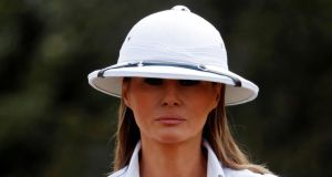 Colonial chic?: Melania Trump in her pith helmet and whites in Nairobi. Photograph: Carlo Allegri/Reuters
