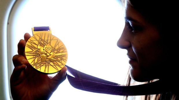 Katie Taylor with her Olympic gold medal from the 2012 Games. Photograph: Dan Sheridan/Inpho